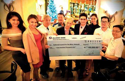 Page 28 of McMillan Woods McC Cares Raises RM100,000 for the Needy