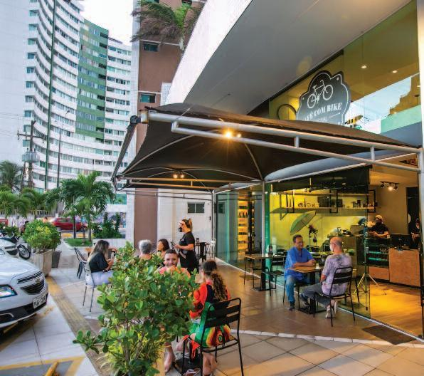 Page 12 of Café Com Bike une ambiente moderno a menu sofisticado